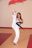 Martial Arts Woman. Second Degree Black Belt Woman royalty free stock image