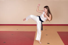 Martial Arts Woman. Second Degree Black Belt Woman royalty free stock photo