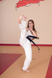 Martial Arts Woman. Second Degree Black Belt Woman royalty free stock images