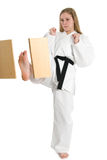 Martial Arts Woman. Black belt female martial artist doing board break royalty free stock images