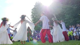 Martial national dances at holiday ivana kupala on nature, boys and girls dancing folk dances in costumes alfresco at stock footage