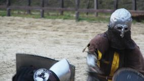 Martial skills competition between two men in medieval armor, attack strategy. Stock footage stock video footage