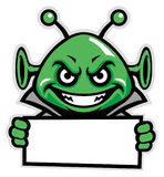 Martian green mascot hold the sign Royalty Free Stock Photography