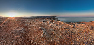 Martian Sunrise. The terrain at Majjistral Park during sunrise. One look at the stones and colour and you could easily think you're on Mars royalty free stock photos