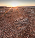 Martian Sunrise. The terrain at Majjistral Park during sunrise. One look at the stones and colour and you could easily think you're on Mars royalty free stock image