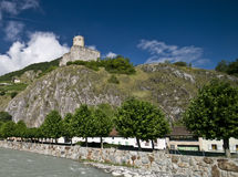 Martigny castle. Swiss town of Martigny, river view of old Roman castle on the hill Royalty Free Stock Photography