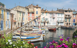 Martigues (Provence, France). Martigues (Bouches-du-Rhone, Provence-Alpes-Cote d'Azur, France): the old harbor with boats and flowers Royalty Free Stock Photography