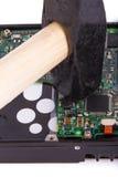Martillo en disco duro Imagenes de archivo