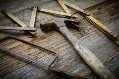 Martillo, sierra y cinta métrica Fotografía de archivo