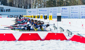 Martin Fourcade (FRA) and other on a firing line Royalty Free Stock Photo