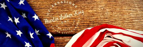 Composite image of martin luther king day. Martin Luther king day against american flag on wooden table stock photography