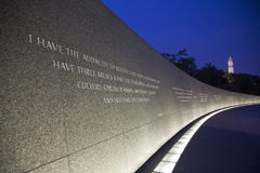 The Martin Luther King Jr. Memorial. And quote with Washington Monument in background, a monument to civil rights leader. Located in Washington, D.C., the stock photography