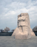 Martin Luther King, Jr. Memorial, Washington, DC. Washington, DC - March 23, 2016 - The large granite statue of Martin Luther King, Jr., with blooming cherry royalty free stock photo