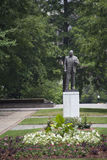 Martin Luther King Jr statue. Historic statue in beautiful park surrounded by green foliage and flowers stock image