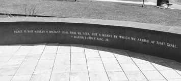 Martin Luther King peace quote engraving at a memorial park. Martin Luther King peace quote engraving at a veteran`s memorial park in Minnesota. `Peace is not Stock Photography