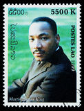 Martin Luther King Postage Stamp. LAOS - CIRCA 1999: A postage stamp printed in Laos showing Martin Luther King, circa 1999 Royalty Free Stock Photography