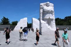 Martin Luther King. WASHINGTON - JUNE 15: People visit Martin Luther King memorial on June 15, 2013 in Washington. 18.9 million tourists visited capital of the stock images