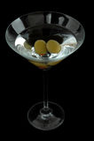 Martini. Classic martini with green olives isolated on a white background Royalty Free Stock Photos