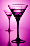 Martini. Glass on purple background (shallow depth of field Stock Images