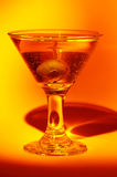 Martini. Vodka and an Olive - Martini Stock Photography