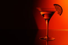 Martini. With half red half black background Royalty Free Stock Photography