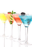 Martini Alcohol Cocktails In Row Blue Royalty Free Stock Image