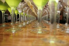 Martini anyone?. Row of martini glasses Stock Image