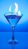 Martini azul llameante Foto de archivo libre de regalías