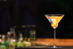 Martini at the bar counter. Classic cocktail in the bar Stock Image