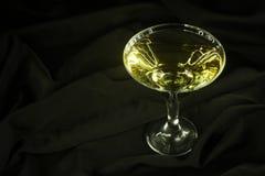 Martini on black cloth Stock Photography