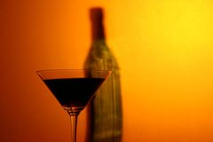 Martini and bottle. A bottle and a glass of martini Royalty Free Stock Photography