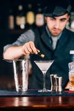 Martini, classic cocktail with olives, vodka and gin served cold in restaurant, pub or bar Royalty Free Stock Photo