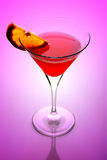 Martini cocktail. Against pink background Royalty Free Stock Photography