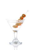 Martini cocktail. Classic Martini with vodka, five little green olives filled by red pepper inside isolated on a white background Royalty Free Stock Photos
