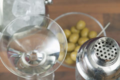 Martini cocktail. Martini in glass, cocktail shaker, olives and ice bucket Royalty Free Stock Image