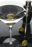 Martini cocktail drink and olives Stock Images