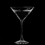 Martini in a cocktail glass on black background Stock Images