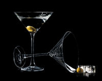 Martini in a cocktail glasses with olives and ice isolated on bl Royalty Free Stock Photography