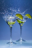 Martini cocktail with lime and splash royalty free stock photos
