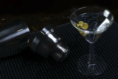 Martini cocktail. With shaker and olives royalty free stock photos