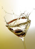 Martini cocktail splashing Royalty Free Stock Photos