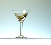Martini cocktail with two olives Stock Images