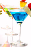 Martini Cocktails drinks composition. Tropical Martini Cocktails drink blue green and red on top composition with vodka, light rum, gin, tequila, blue curacao Stock Images