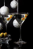 Martini Cocktails for Holiday Party. Two martini cocktails and olives with holiday ornaments in background. A concept for a formal holiday party Stock Photography