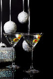 Martini Cocktails 2. Two martini cocktails with olives with holiday ornaments and ladies sequined handbag blurred in background stock photo