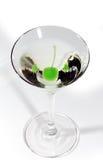 Martini con una cereza Imágenes de archivo libres de regalías