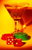 Martini and Dice. Martini Glass With Dice and Chips Stock Images