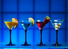 Martini. Different cocktails or longdrinks garnished with fruits Royalty Free Stock Photos