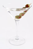 Martini dirty. Frontal of a dirty martini with 4 pimento stuffed olives Royalty Free Stock Images