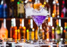 Martini drink served on bar counter Royalty Free Stock Image